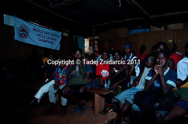 Coach George Mukhobe and baseball players watch the Little League World Series game between Saudi Arabia and Canada on August 19th 2011 in the video hall in Nsambya, neighbourhood of capital Kampala, Uganda.