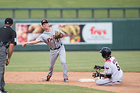 Mesa Solar Sox shortstop AJ Simcox (17), of the Detroit Tigers organization, makes a throw to first base in front of a sliding Victor Reyes (5) and umpire John Libka during an Arizona Fall League game against the Salt River Rafters on October 30, 2017 at Salt River Fields at Talking Stick in Scottsdale, Arizona. The Solar Sox defeated the Rafters 8-4. (Zachary Lucy/Four Seam Images)