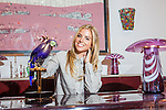 Interior designer Sasha Bikoff at her new store in Tribeca. She sits at a lucite and chrome vintage Fabio Lenci desk with a Pierre Cardin credenza in the background. <br /> <br /> Danny Ghitis for The New York Times