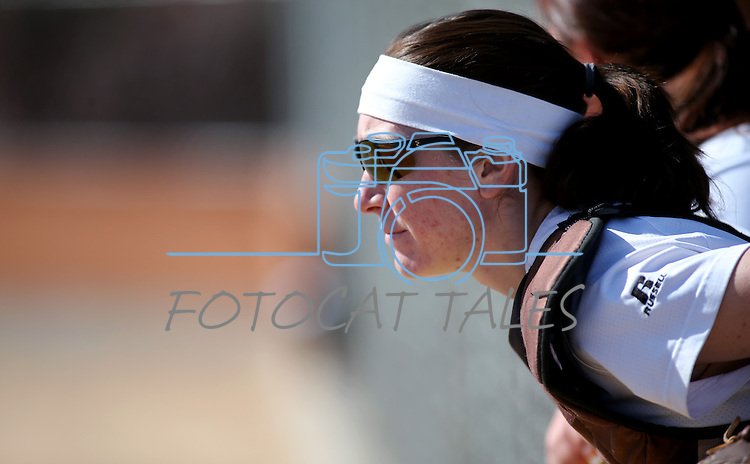 Western Nevada College's Alia Cox watches the action in a college softball game against Colorado Northwestern on Friday, Feb. 22, 2013, in Carson City, Nev..Photo by Cathleen Allison