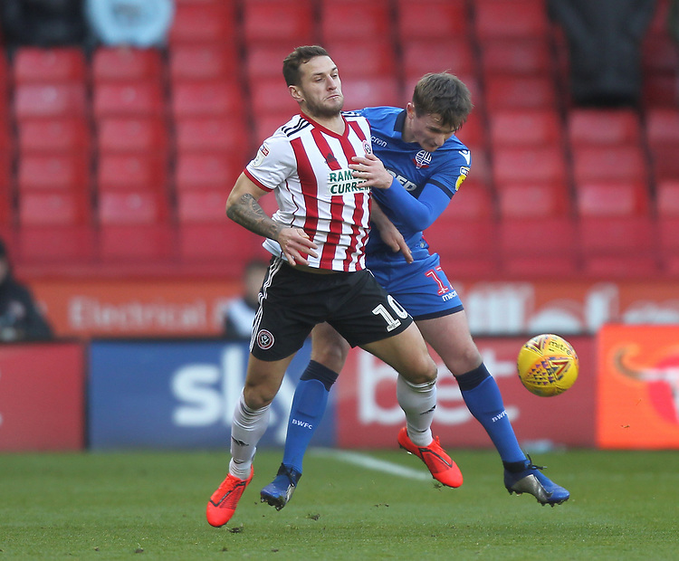 Bolton Wanderers Callum Connolly battles with  Sheffield United's Billy Sharp<br /> <br /> Photographer Mick Walker/CameraSport<br /> <br /> The EFL Sky Bet Championship - Sheffield United v Bolton Wanderers - Saturday 2nd February 2019 - Bramall Lane - Sheffield<br /> <br /> World Copyright © 2019 CameraSport. All rights reserved. 43 Linden Ave. Countesthorpe. Leicester. England. LE8 5PG - Tel: +44 (0) 116 277 4147 - admin@camerasport.com - www.camerasport.com