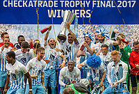 Jordan Willis of Coventry City lifts the cup as he &  teammates celebrate winning the checkatrade trophy during the The Checkatrade Trophy / EFL Trophy FINAL match between Oxford United and Coventry City at Wembley Stadium, London, England on 2 April 2017. Photo by Andy Rowland.