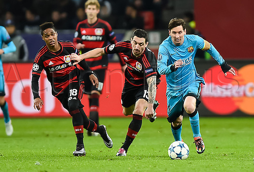 09.12.2015. Leverkusen, Germany.  Barcelona's Lionel Messi (R-L)  gets past the defense of Leverkusen's Roberto Hilbert and Leverkusen's Wendell during the UEFA Champions League group E soccer match between Bayer 04 Leverkusen and FC Barcelona in Leverkusen, Germany, 09 December 2015.