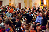 Washington, DC - October 31, 2009 -- United States President Barack Obama reacts to performers during a Halloween reception for military families and children of White House staff in the East Room of the White House, October 31, 2009. U.S. Secretary of Education Arne Duncan is at right. .Mandatory Credit: Pete Souza - White House via CNP