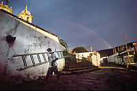 A morning rainbow arches over the parish church of Santo Antonio (circumflex over the o in Antonio) in Tiradentes, Brazil. Brazil's interior state of Minas Gerais, once a colonial mining capitol for the Portuguese crown, has changed little in appearance since the 18th century. With the help of laws to preserve its baroque architecture, the state's sky is scraped at every turn by 250-year-old church steeples, and lined with cobblestones. (Kevin Moloney for the New York Times)