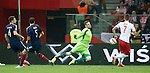 David Marshall chests the ball away from Milik