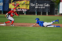 Brayan Morales (8) of the Ogden Raptors dives to second base while Franklin Torres (6) of the Orem Owlz fields the throw in Pioneer League action at Lindquist Field on June 22, 2017 in Ogden, Utah. The Owlz defeated the Raptors 13-8.  (Stephen Smith/Four Seam Images)