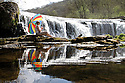 07/05/13 ..As temperatures continue to rise, Emma Garfitt, cools off as she watches the River Wye cascading down Monsal Weir in The Peak District National Park, near Bakewell in Derbyshire...All Rights Reserved - F Stop Press.  www.fstoppress.com. Tel: +44 (0)1335 300098.