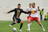 Nick Zimmerman (23) of the Philadelphia Union is marked by Joel Lindpere (20) of the New York Red Bulls. The New York Red Bulls defeated the Philadelphia Union 2-1 during a Major League Soccer (MLS) match at Red Bull Arena in Harrison, NJ, on April 24, 2010.