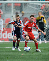 23 May 09: New England Revolution midfielder Steve Ralston #14 and Toronto FC midfielder Jim Brennan #11 in action during a game between the New England Revolution and Toronto FC.Toronto FC won 3-1.