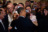 United States President Barack Obama holds a baby after delivering remarks at the Democratic National Committee (DNC) winter meeting on Saturday, February 6, 2010 in Washington, DC. Top party officials and supporters gathered for the annual meeting to map out their agenda for the year.  .Credit: Brendan Hoffman - Pool via CNP