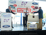 Ford CEO Eddie Murphy pulls the winning ticketsand hands them to Superintendent Gerry Smith at the Monster car draw in Smith's garage in aid of the Gary Kelly Cancer Support Centre. Photo:Colin Bell/pressphotos.ie