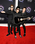 LOS ANGELES, CA - NOVEMBER 24: (L-R) Mike Dirnt, Billie Joe Armstrong and Tré Cool of Green Day attend the 2019 American Music Awards at Microsoft Theater on November 24, 2019 in Los Angeles, California.