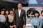 """September 21, 2016, Tokyo, Japan - Japan's cosmetics giant Shiseido president Masahiko Uotani (C) smiles with the company's professional make-up artists as Shiseido will launch the new make-up brand """"Playlist"""" in Tokyo on Wednesday, September 21, 2016. Playlist is developed by Shiseido's professional make-up artists and users will be able to have web counselling and make-up tips through the Internet.   (Photo by Yoshio Tsunoda/AFLO) LWX -ytd-"""