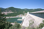 "Libby Dam, near Libby, Montana on the Kootenai River forms scenic Lake Koocanusa.   Lake Koocanusa lies north of Libby, Montana and is formed by Libby Dam, blocking the Kootenai River and forming a resevoir nearly four hundred feet deep and fourty-eight miles long.  Scenic drives encircle the lake crossing over at the ""long bridge"", Montana's longest span."