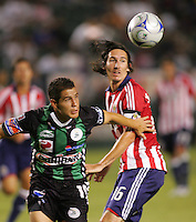 Santos Laguna defender Rafael Figueroa (19)  and Chivas USA midfielder Sacha Kljestan (16) do battle. Chivas USA defeated the Santos of Laguna 1-0 during the 1st round of the 2008 SuperLiga at Home Depot Center stadium, in Carson, California on Wednesday, July 16, 2008.
