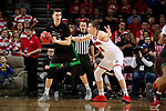 SIOUX FALLS, SD - MARCH 8: Gertautas Urbonavicius #32 of the North Dakota Fighting Hawks pivots and drives to the basket against Tasos Kamateros #34 of the South Dakota Coyotes at the 2020 Summit League Basketball Championship in Sioux Falls, SD. (Photo by Dave Eggen/Inertia)