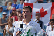 Washington, DC - August 3, 2014: Milos Raonic of Canada speaks to fans in the Fitzgerald Tennis Center after winning the Citi Open in straight sets over fellow Canadian Vasek Pospisil, August 3, 2014.  (Photo by Don Baxter/Media Images International)