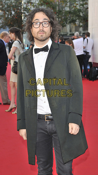 Sean Lennon.Arrivals to the UK Premiere of 'George Harrison: Living In The Material World' at BFI Southbank, London, England..October 2nd, 2011.half length black tuxedo jacket white shirt glasses beard facial hair bow tie jeans denim.CAP/CAN.©Can Nguyen/Capital Pictures.