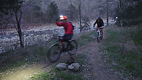 NWA Democrat-Gazette/FLIP PUTTHOFF <br /> Riders take off for the night ride along the Fossil Flats Trail. The trail is normally closed after dark, but a night ride was held April 1, 2016 during the Ozark Mountain Bike Festival.