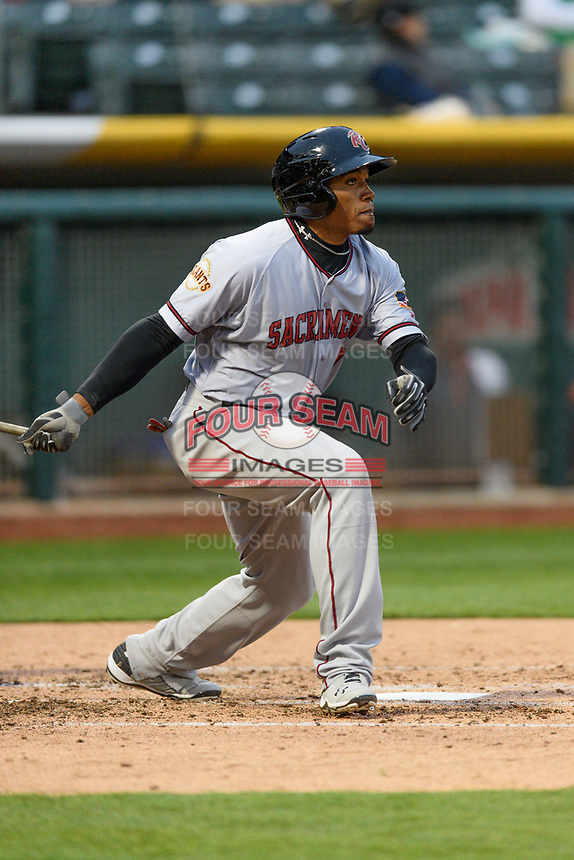 Carlos Moncrief (9) of the Sacramento River Cats follows through on his swing against the Salt Lake Bees during the Pacific Coast League game at Smith's Ballpark on August 11, 2017 in Salt Lake City, Utah.The River Cats defeated the Bees 8-7. (Stephen Smith/Four Seam Images)