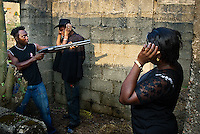 Actors rehearsing as vigilantes on the set of a Nollywood movie production. Violence is often part of Nollywood movies.