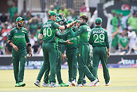High fives as Mohammad Amir (Pakistan) picks up the wicket of Soumya Sarkar (Bangladesh) during Pakistan vs Bangladesh, ICC World Cup Cricket at Lord's Cricket Ground on 5th July 2019