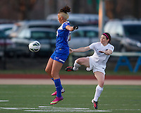 In a National Women's Soccer League Elite (NWSL) match, the Boston Breakers and  Washington Spirit drew 1-1, at the Dilboy Stadium on April 14, 2012.  Boston Breakers forward Lianne Sanderson (10) leaps top control a high ball as Washington Spirit midfielder Diane Matheson (8) reacts.