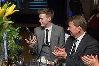Journalist and presenter, Bill Turnbull (right), appears impressed with the magician's bottle dissapearing trick during the Wycombe Wanderers End of Season 2016 Awards Dinner at Adams Park, High Wycombe, England on 1 May 2016. Photo by David Horn