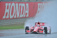 Scott Dixon, of New Zealand, shoots a rooster tail of rain during an IZOD Indycar Series practice session Friday afternoon at Barber Motorsports Park in Birmingham, Alabama.