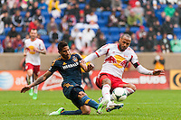 Sean Franklin (5) of the Los Angeles Galaxy and Thierry Henry (14) of the New York Red Bulls. The New York Red Bulls defeated the Los Angeles Galaxy 1-0 during a Major League Soccer (MLS) match at Red Bull Arena in Harrison, NJ, on May 19, 2013.