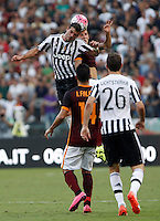 Calcio, Serie A: Roma vs Juventus. Roma, stadio Olimpico, 30 agosto 2015.<br /> Juventus&rsquo; Stefano Sturaro, top left, and Roma&rsquo;s Lucas Digne jump for the ball during the Italian Serie A football match between Roma and Juventus at Rome's Olympic stadium, 30 August 2015.<br /> UPDATE IMAGES PRESS/Isabella Bonotto