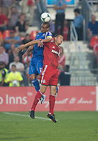 03 July 2013: Montreal Impact defender Matteo Ferrari #13 and Toronto FC forward Danny Koevermans #14 in action during an MLS game between the Montreal Impact and Toronto FC at BMO Field in Toronto, Ontario Canada.<br /> The game ended in a 3-3 draw.