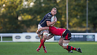Mark Bright (Captain) of London Scottish in tackled by Mark McCrea of Jersey during the Greene King IPA Championship match between London Scottish Football Club and Jersey at Richmond Athletic Ground, Richmond, United Kingdom on 7 November 2015. Photo by Andy Rowland.