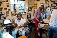 SOWETO, SOUTH AFRICA JULY 3: Sibu Sithole (l), a young designer part of the group Smarteez work on a collection with his colleague Lethabo Tsatsinyane in their workshop on July 3, 2014 in Jabulani section of Soweto, South Africa. Soweto today is a mix of old housing and newly constructed townhouses. A new hungry black middle-class is growing steadily. Many residents work in Johannesburg but the last years many shopping malls have been built, and people are starting to spend their money in Soweto. (Photo by: Per-Anders Pettersson)