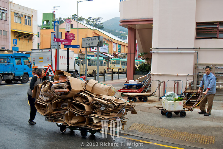Hong Kong  Sair Kung, Hong Kong  An elderly woman in Sai Kung scavenges cardboard on her trolley to earn a few dollars beyond her minimal pension.