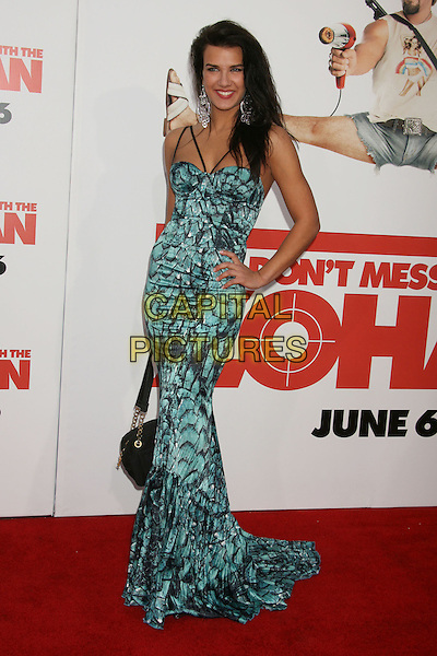 """NATALIA GUSLISTAYA.""""You Don't Mess With The Zohan"""" LA Premiere at Grauman's Chinese Theatre, Hollywood, California, USA,.28 May 2008..full length  blue green print maxi long dress hand on hip black turquoise.CAP/ADM/MJ.©Michael Jade/Admedia/Capital Pictures"""