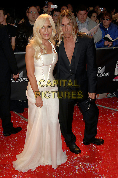 "DONATELLA VERSACE, IGGY POP.""Swarovski Fashion Rocks"" concert at the Royal Albert Hall.18th October 2007  London, England.full length white dress.CAP/PL.©Phil Loftus/Capital Pictures"
