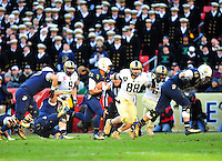 Navy's Aaron Santiago rushes against Army's defense. Navy Midshipmen defeated Army Black Knights 27-21 during the Army vs. Navy game at the FedEx field in Landover, MD on Saturday, December 10, 2011. Alan P. Santos/DC Sports Box