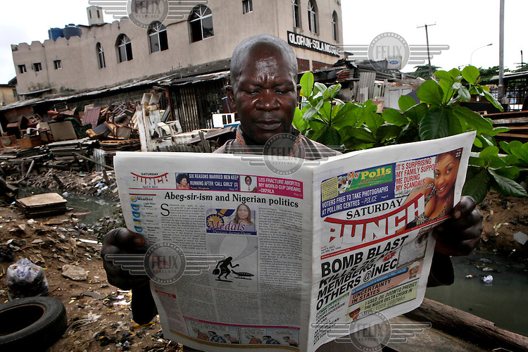 A man reads a local newspaper in Lagos. Nigerians turned out for a delayed parliamentary election on 9 April 2011 to make their choices on who represents them.