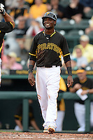 Shortstop Alen Hanson (63) of the Pittsburgh Pirates waits to greet Tony Sanchez after a home run during a spring training game against the New York Yankees on February 26, 2014 at McKechnie Field in Bradenton, Florida.  Pittsburgh defeated New York 6-5.  (Mike Janes/Four Seam Images)