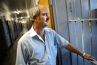 Former prison warder Christo Brand was one of the warders directly assigned to guard Nelson Mandela at Robben Island prison between 1978 and 1987, he was in charge of the educational studies of Nelson Mandela and a few other prisoners. He stands at the entrance to the cell Mandela occupied. The prison is now a museum and major tourist attraction..