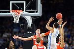 02 APR 2016: Forward Brice Johnson (11) of the University of North Carolina shoots over Forward Tyler Lydon (20) of Syracuse University during the 2016 NCAA Men's Division I Basketball Final Four Semifinal game held at NRG Stadium in Houston, TX. North Carolina defeated Syracuse 83-66 to advance to the championship game.  Brett Wilhelm/NCAA Photos