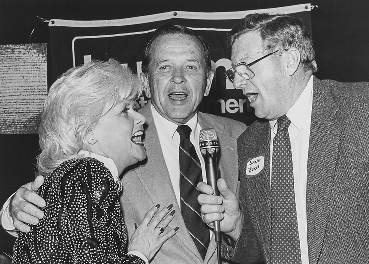 Carolanee Preziotti, Sen. Ted Stevens, R-Alaska, and Sen. Conrad Burns, R-Mont., singing jingle bells (Carolanne is a volunteer and patient). (Photo by Chris Ayers/CQ Roll Call via Getty Images)