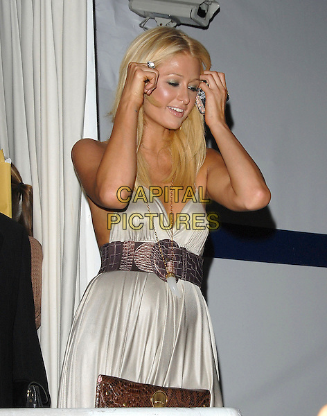 PARIS HILTON.At The Paris Hilton CD Release Party held at Privelege in West Hollywood, California, USA, August 18, 2006..half length grey halterneck dress ring brow waist belt gold necklace crocodile skin effect.Ref: DVS.www.capitalpictures.com.sales@capitalpictures.com.©Debbie VanStory/Capital Pictures