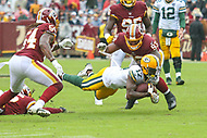 Landover, MD - September 23, 2018: Green Bay Packers wide receiver Davante Adams (17) is tackled by Washington Redskins defensive end Jonathan Allen (93) during the  game between Green Bay Packers and Washington Redskins at FedEx Field in Landover, MD.   (Photo by Elliott Brown/Media Images International)