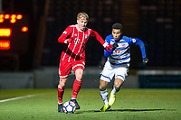 Felix Gotze of Bayern Munich II holds off Danny Loader of Reading during the Premier League International Cup match between Reading U23 and Bayern Munich II at the Adams Park, Wycombe, England on 8 December 2017. Photo by Andy Rowland.