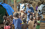 Josephine Murigi, a sister of Our Lady of the Missions and a member of Solidarity with South Sudan, sings with children in a camp for more than 5,000 displaced people in Riimenze, in South Sudan's Gbudwe State, what was formerly Western Equatoria. Families here were displaced at the beginning of 2017 as fighting between government soldiers and rebels escalated.<br /> <br /> Murigi, originally from Kenya, also provides pastoral accompaniment in the Riimenze parish, which has been overwhelmed with the displaced families. <br /> <br /> Solidarity with South Sudan is an international network of Catholic groups that provides training in South Sudan to teachers and health workers, as well as offering pastoral accompaniment to the people of the world's newest nation. Solidarity and Caritas Austria have both supported efforts by the diocese to ensure that the displaced families here have food, shelter and water.