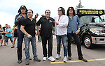 SIOUX FALLS, SD - JULY 20: KISS members Gene Simmons, Eric Singer, Paul Stanley and Tommy Thayer pose for photos with Chuck Brennan, center, founder of the Brennan Rock & Roll Academy Saturday afternoon in Sioux Falls.  (Photo by Dave Eggen/Inertia)