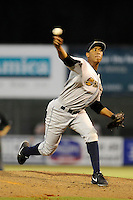 Pitcher Angel Rincon (13) of the Charleston RiverDogs delivers a pitch in a game against the Kannapolis Intimidators on Saturday, June 28, 2014, at CMC-Northeast Stadium in Kannapolis, North Carolina. Kannapolis won, 4-3. (Tom Priddy/Four Seam Images)